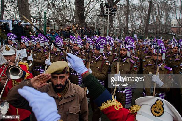 Indian policemen give guard of honor to the coffin bearing the body of pro Indian Jammu and Kashmir Chief Minister Mufti Mohammad Sayeed during his...