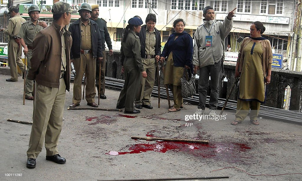 Indian Policemen inspect the site were President of the Akhil Bharatiya Gorkha League (ABGL), Madan Tamang was repeatedly stabbed with swords and kukris in Darjeeling on May 21,2010. Tension gripped the eastern Indian hill town of Darjeeling with the murder of a separatist leader campaigning for a new state for ethnic Nepalese speakers, police said. Security in the tea-growing region in West Bengal was stepped up after Madan Tamang, president of the All India Gorkha League, was fatally stabbed as he was about to address a public meeting.