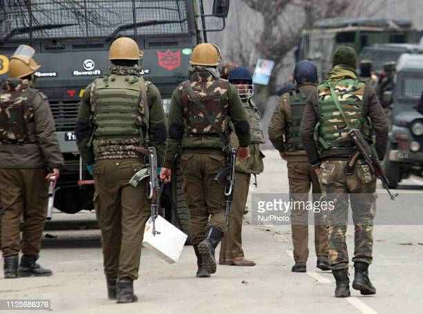 Indian policemen move towards the encounter site in Pinglena area of Pulwama some 30 kilometers from Srinagar Kashmir on February 18 2019Nine people...
