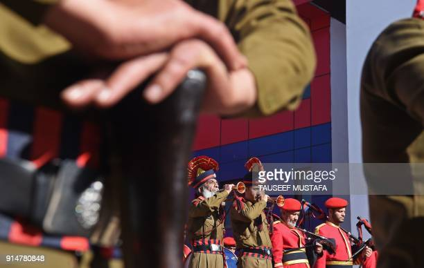 TOPSHOT Indian policemen play bagpipes during a wreath laying ceremony for a slain colleague in Srinagar on February 6 2018 Two gunmen opened fire on...