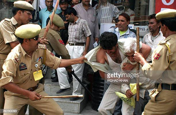 Indian policemen scuffle with protesting employess during a demonstration in Srinagar 23 August 2007 Hundreds of employees in Indian Kashmir who work...