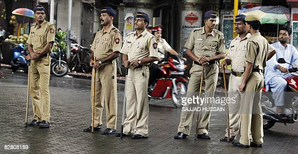 Indian policemen stand alert on a street in Mumbai on September 14 2008 Police and security forces in Mumbai were on high alert after deadly bomb...