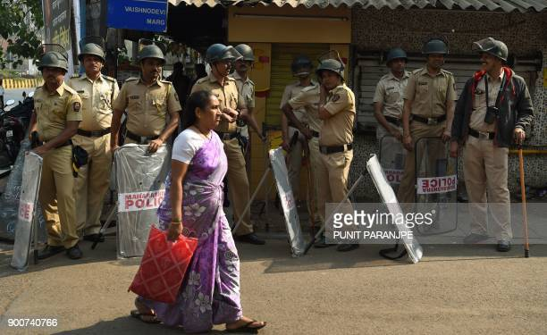 Indian policemen stand guard during Republican Party of India supporters protest in Mumbai on January 3 2018 India's Republican Party supporters took...
