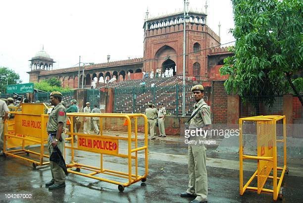 Indian policemen stand guard outside of gate 3 of the Jama Masjid mosque after gunmen attacked foreign tourists in New Delhi on September 19 2010 in...