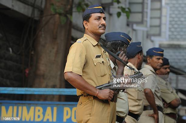 Indian policemen stand guard outside the high court where Mohammed Ajmal Amir Kasab's appeal is being held in Mumbai on February 7 2011 Two Indian...