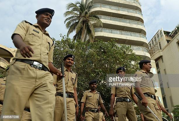 Indian policemen stand guard outside the home of Bollywood actor Aamir Khan in Mumbai on November 24 2015 Aamir Khan a top Bollywood actor who...