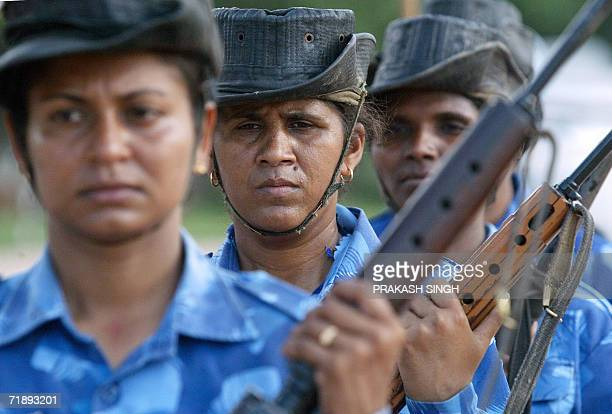 Indian policewomen of the Central Reserve Police Force practice their riot control skills during training at a camp of the CRPF's elite Rapid Action...