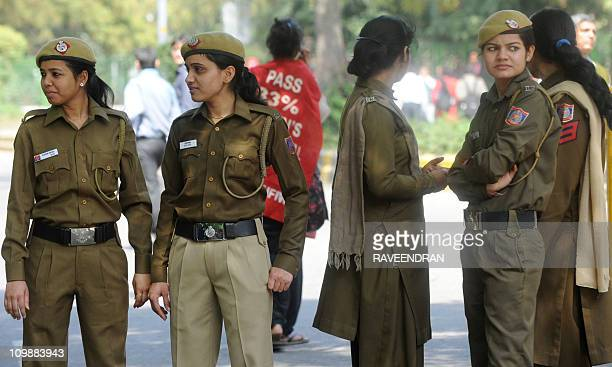 Indian policewomen stand guard during a protest rally during International Women's Day in New Delhi on March 8 2011 International Women's Day is...