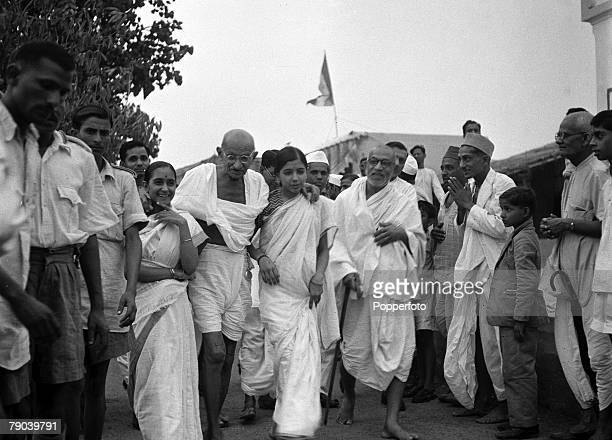 Indian political and spiritual leader Mahatma Gandhi who is 78 years old in this picture leads the procession for evening prayers which always start...