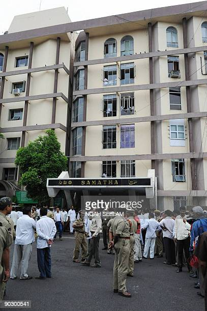 Indian political leaders and police personnel await news outside the Chief Minister's chambers at the Secretariat in Hyderabad on September 2 2009 A...