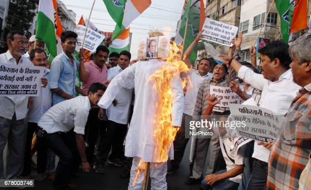 Indian Political Party Congress workers today burn Pakistan National flag and Pakistam Prime Minister Nawaz Sharif Effigy and protest against killing...