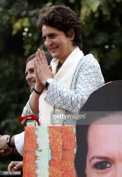 Indian political scion Priyanka Gandhi Vadra gestures at a rally with her brother Congress Party leader Rahul Gandhi in Lucknow the capital of the...