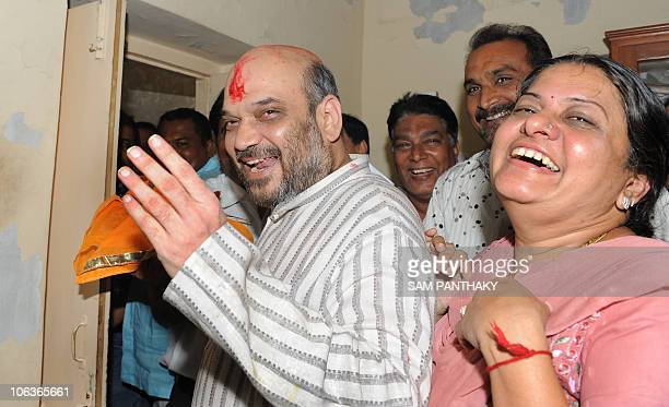 Indian politician and former Gujarat minister Amit Shah and his wife Sonalben arrive at his residence after he was released from Sabarmati Central...