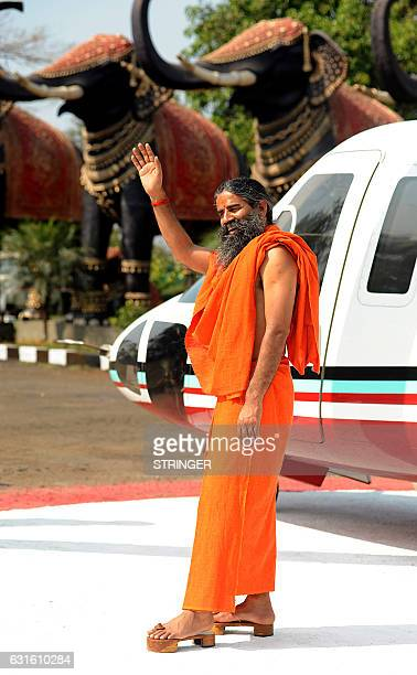 Indian politician and yoga teacher Baba Ramdev founder of the Patanjali Group arrives for the mahurat of upcoming Hindi television serial Vidrohi...