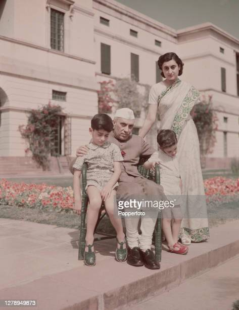 Indian politician Jawaharlal Nehru Prime Minister of India seated with his daughter Indira Gandhi and her two sons Rajiv Gandhi and Sanjay Gandhi at...