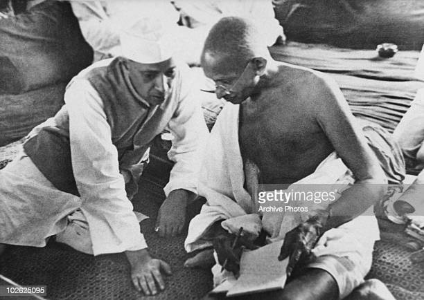 Indian politicians Jawaharlal Nehru and Mahatma Gandhi in conversation at a session of the All India Congress Committee in Bombay 8th August 1942 It...