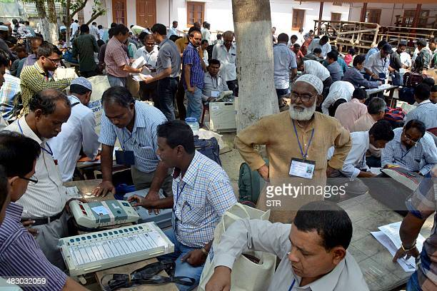 Indian poll officials check Electronic Voting Machines at a distribution centre in Nagaon some 180 kms east of Guwahati on April 6 2014 ahead of Lok...