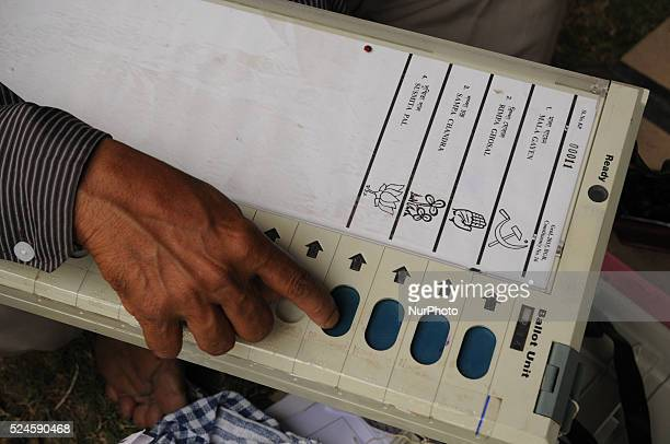 Indian polling officials caked Electronic Voting Machines before being assigned designated polling stations for the forthcoming corporation elections...
