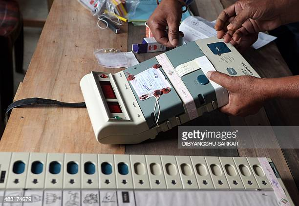 Indian polling officials seal an Electronic Voting Machine infront of polling agents prior to the start of voting at a polling station in Dibrugarh...