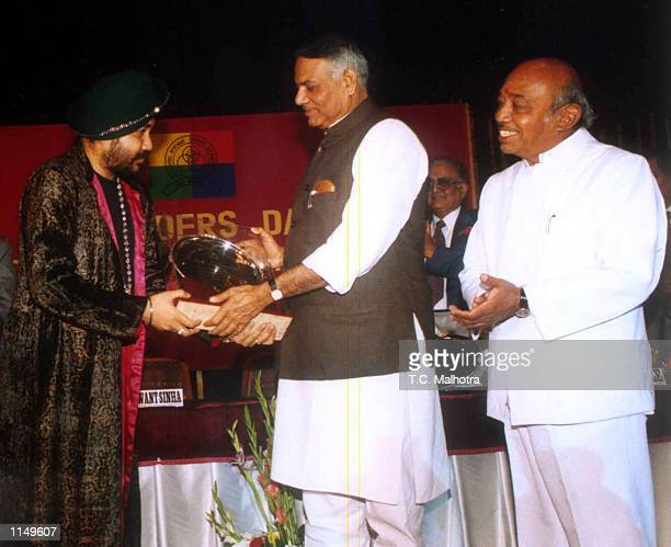 Indian Pop king Daler Mehandi being honoured by finance minister Yaswant Sinha at a function in New Delhi on January 41998