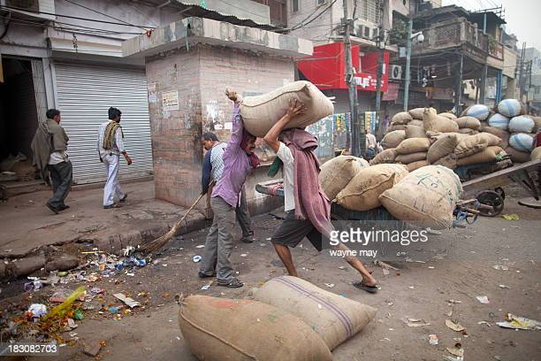 CONTENT] Indian porters carry sacks of dried fruit and nuts which will be sold at the spice market in the old part of the city