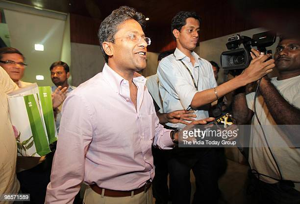 Indian Premier League Commissioner Lalit Modi came out of his Worlibased office early on Friday after Income Tax officials grilled him for eight...