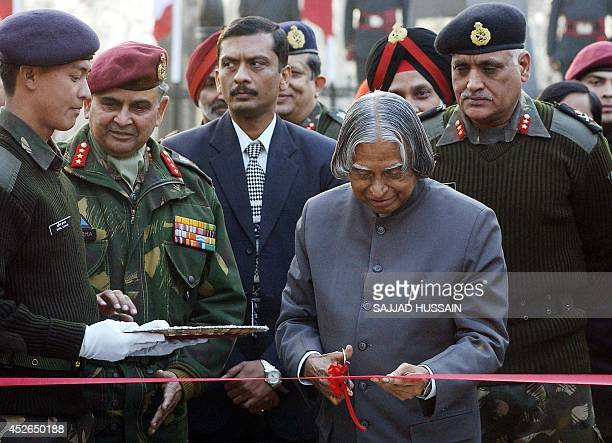 Indian President Abdul Kalam cuts a ribbon as he inaugurates a museum inside Srinagar's army headquarters compound 08 December 2004 Muslim rebels in...
