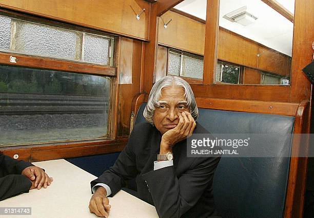 Indian President Abdul Kalam sits in a train as he retraces the step of the father of the Indian nation Mahatma Gandhi on a train ride to...