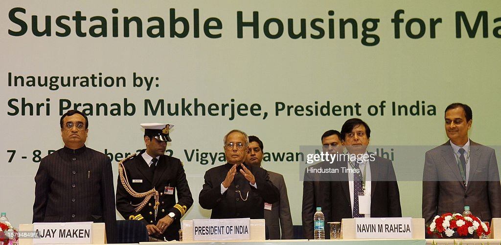Indian President Pranab Mukherjee (C), Ajay Maken, Union Minister of Housing and Urban Poverty Alleviation (L), Navin M Raheja, President National Real Estate Development Council (2nd R) and Sunil Mantri Vice President (NARDECO) at the inauguration of Eleventh National Convention on 'Sustainable Housing Masses' at Vigyan Bhavan on December 7, 2012 in New Delhi, India.