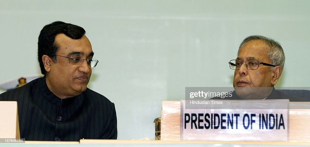 Indian President Pranab Mukherjee (R) and Ajay Maken, Union Minister of Housing and Urban Poverty Alleviation at the inauguration of Eleventh National Convention on 'Sustainable Housing Masses' at Vigyan Bhavan on December 7, 2012 in New Delhi, India.