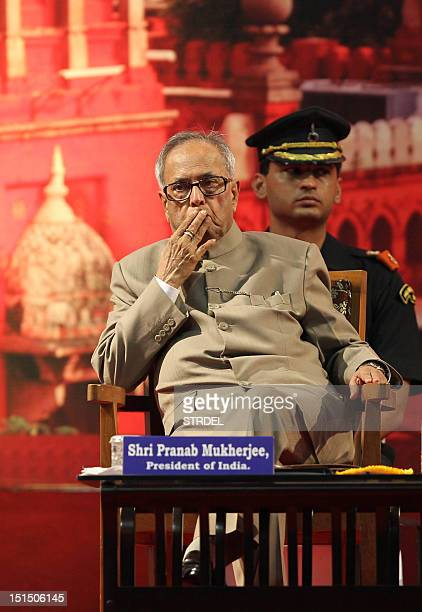 Indian President Pranab Mukherjee gestures during celebrations at the High Court of Madras in Chennai on September 8 2012 President Mukherjee arrived...
