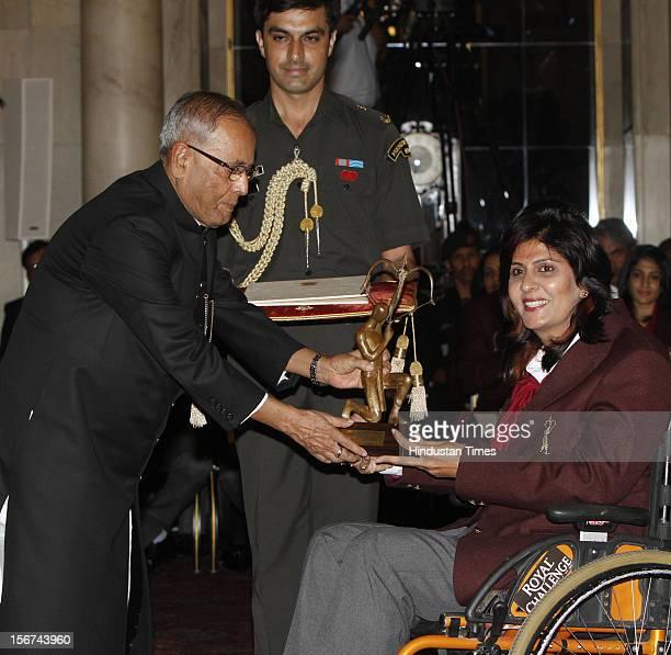 'NEW DELHI INDIA AUGUST 29 Indian President Pranab Mukherjee presenting the Arjun Award to Para Athlete Deepa Malik during the Sports and Adventure...