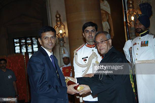 Indian President Pranab Mukherjee presents the Padma Bhushan award to former Indian cricket captain Rahul Dravid during the presentation of the...