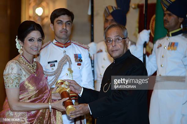 Indian President Pranab Mukherjee presents the Padma Shree award to Indian film actress Sridevi during the presentation of the 'Padma Awards 2013' at...