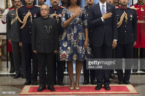 Indian President Pranab Mukherjee stands for the American National Anthem alongside US President Barack Obama and First Lady Michelle Obama prior to...