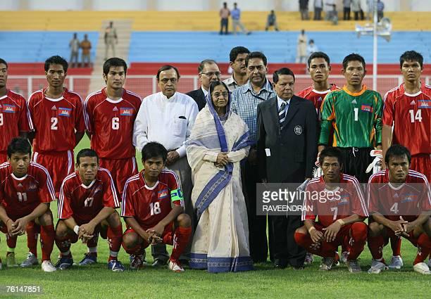 Indian President Pratibha Patil accompanied by Indian Parliamentary Affairs Minister Priya Ranjan Dasmunsi poses with the Cambodian football team...
