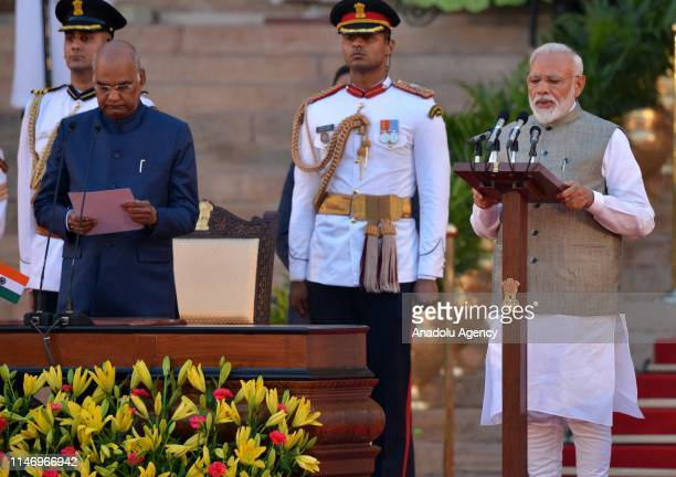Indian President Ram Nath Kovind administers the oath of office to Narendra Modi as Prime Minister during the swearingin ceremony at the presidential...