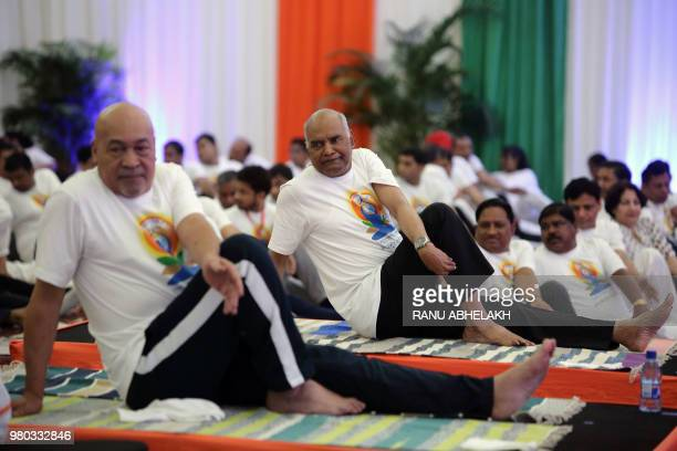 Indian President Ram Nath Kovind and Suriname's President Desi Bouterse take part in a yoga class on the 4th International Yoga Day in Paramaribo...