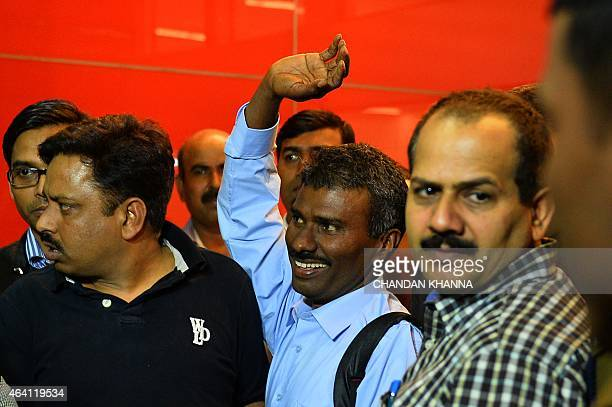 Indian priest Father Alexis Prem Kumar waves as he leaves Indira Gandhi International Airport in New Delhi on February 22 following his release from...