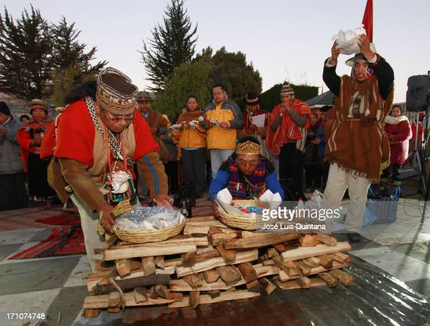 Indian priests nown as Yatiris make an offering with confectionery sugar and coca leaves during the Aymara new year celebration 5521 at Laykakota...