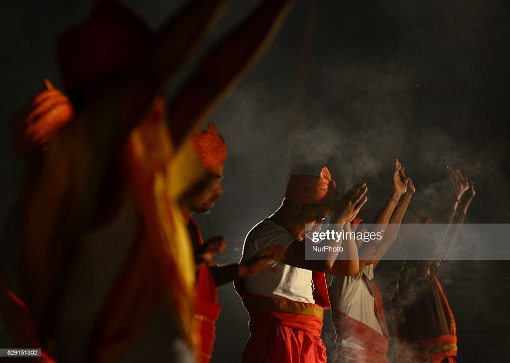 Indian priests perform an evening prayer, on the banks of Holy sangam, confluence of Ganges,yamuna and Mythical Saraswati river, in Allahabad on December 11,2016.