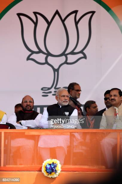 Indian Prime Minister and Bharatiya Janata Party Leader Narendra Modi lookson during a state assembly election rally in Ghaziabad on February 8 in...