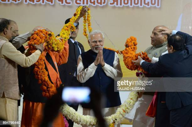 Indian Prime Minister and head of the Bharatiya Janata Party Narendra Modi gestures at the start of a speech at the party headquarters in New Delhi...