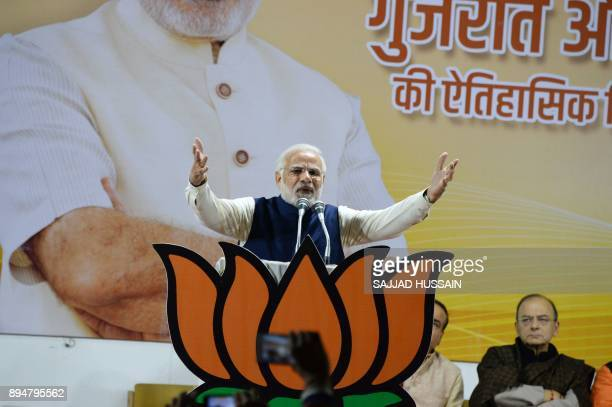 Indian Prime Minister and head of the Bharatiya Janata Party Narendra Modi speaks at the party headquarters in New Delhi on December 18 2017 Indian...