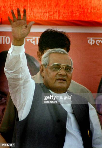 Indian Prime Minister and leader of the Hindu nationalist Bhartiya Janata Party Atal Bihari Vajpayee waves to supporters at election rally in Aligarh...