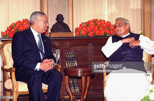 Indian Prime Minister Atal Behari Vajpayee speaks to US Secretary of State Colin Powell during a meeting in New Delhi India on July 28 2002 Colin...