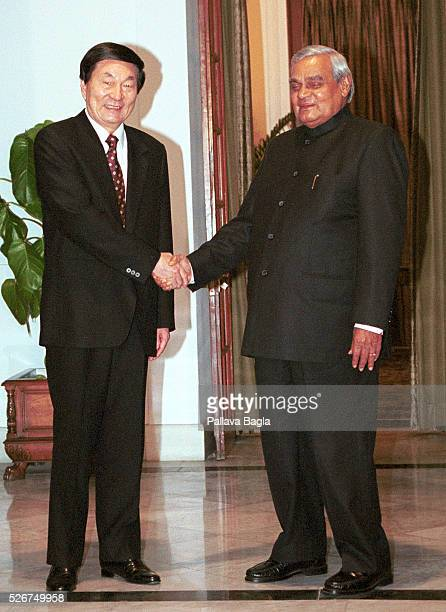 Indian Prime Minister Atal Bihari Vajpayee shakes hands with Chinese Premier Zhu Rongji before a meeting in New Delhi. --- Photo by Pallava...