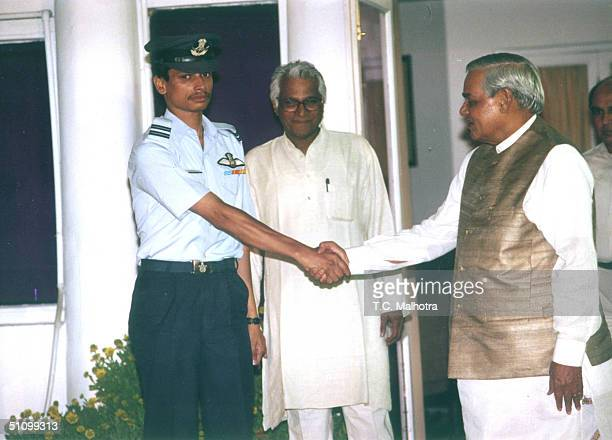 Indian Prime Minister Atal Bihari Vajpayee Shakes Hands With Flight Lieutenant K Nachiketa As Defense Minister George Fernandes Looks On In New Delhi...