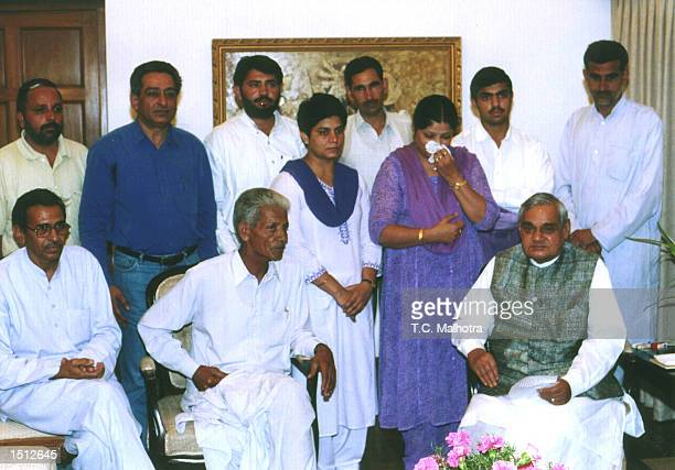 Indian Prime Minister Atal Bihari Vajpayee with relatives of Fijian Prime Minister Mahendra Chaudhry May 23 2000 in New Delhi India Chaudhry is still...