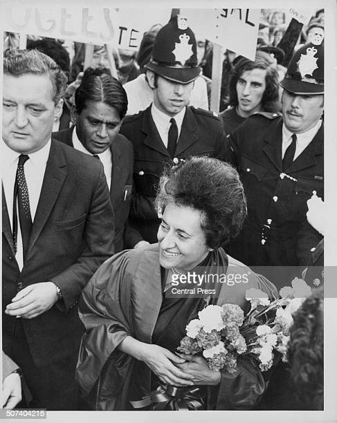 Indian Prime Minister Indira Gandhi escorted by Police men through Oxford during a visit to receive an honorary degree England November 2nd 1971